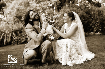 Fine Art Destination Wedding Photographer Orbie Pullen photographed this moment between the bride, groom and their dog during their Wedding.