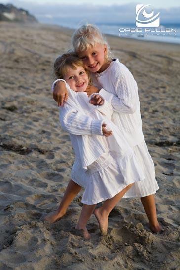 Santa Cruz Family Portrait artist Orbie Pullen captured this portrait of some kids on the Beach in Santa Cruz, Ca.