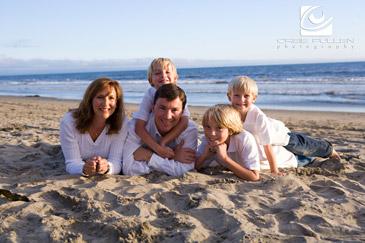 Santa Cruz Family Portrait artist Orbie Pullen shot this photograph of a family on the beach in Santa Cruz, Ca.