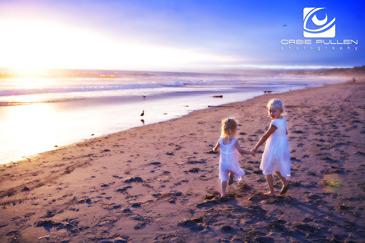 Santa Cruz Family Portrait artist Orbie Pullen captured this unique portrait of some kids on the Beach in Santa Cruz, Ca.