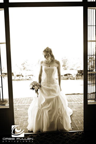 Santa Cruz Fine Art Wedding Photographer Orbie Pullen shot this photograph of a Bride in the doorway at the Hollins House in Santa Cruz, Ca.