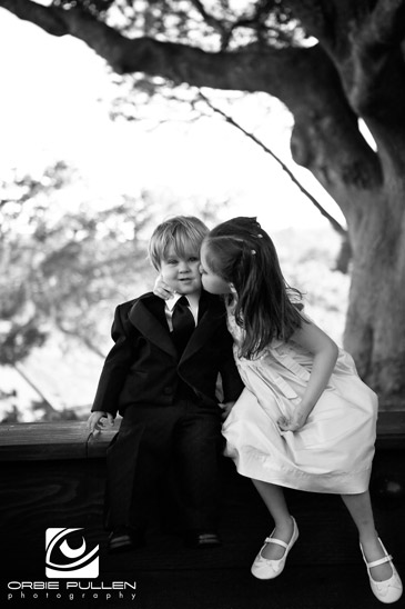 Santa Cruz Fine Art Wedding Photographer Orbie Pullen captured this moment between to kids at a wedding at the Hollins House in Santa Cruz, Ca.