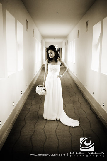Monterey Bay Wedding Photographer Orbie Pullen captured this photo of the bride in Cannery Row in Monterey, Ca.