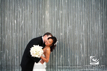 Monterey Bay Wedding Photographer Orbie Pullen captured this photo of the bride and groom in Cannery Row in Monterey, Ca.