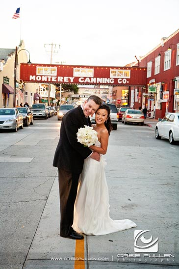 Monterey Bay Wedding Photographer Orbie Pullen captured this photo of the couple in Cannery Row in Monterey, Ca.