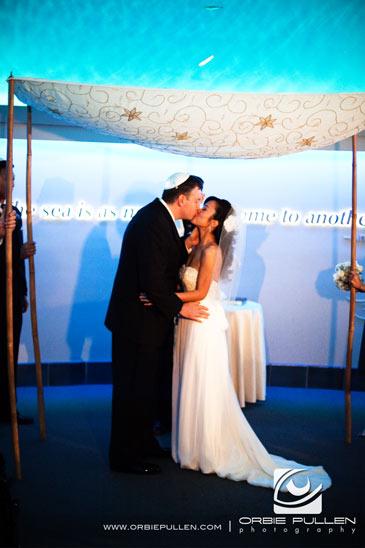 Monterey Bay Wedding Photographer Orbie Pullen captured this photo of the bride and groom in the monterey bay aquarium in Monterey, Ca.