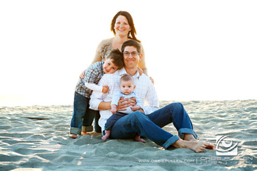 Santa_Cruz_Family_Unique_Portrait_Photographer_Orbie_Pullen_Captured_This_Photograph_of_a_Family_on_a_beach_in_the_Santa_Cruz_Area.